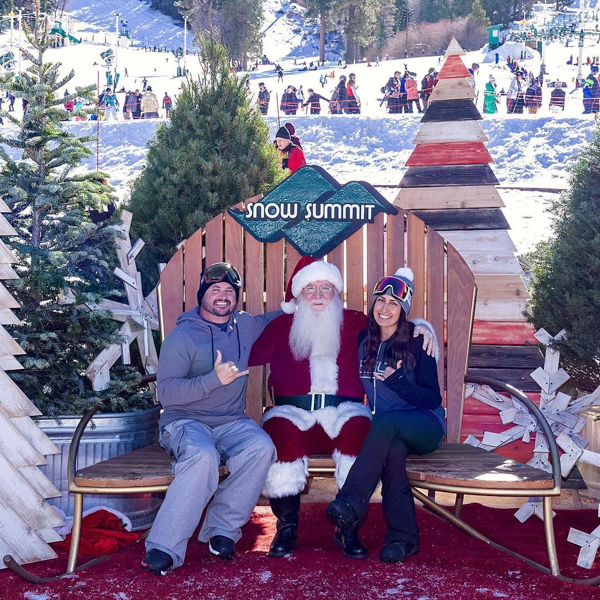 two people taking a photo with santa